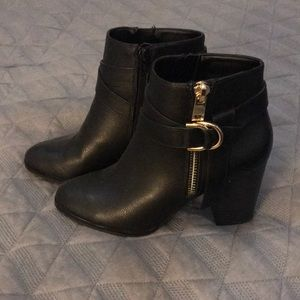 High heel black leather boots